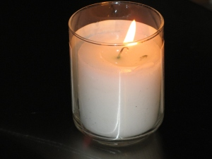 A yahrzeit/anos/memorial candle, lit to commemorate the anniversary of a loved one's death. The candle burns for 24 hours and is lit the night before the day of the anniversary.