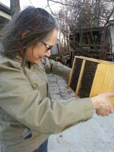 A woman and a package of bees.