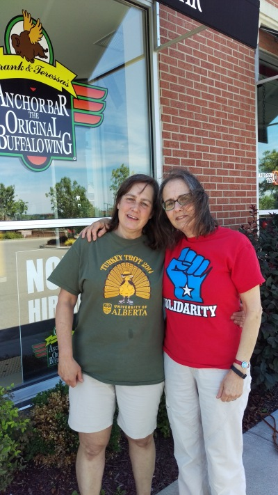A post-lunch photo in Buffalo, taken by Debby's college classmate and longtime family friend Jerry. Note that we are both wearing T-shirts with ties to our adopted homes.